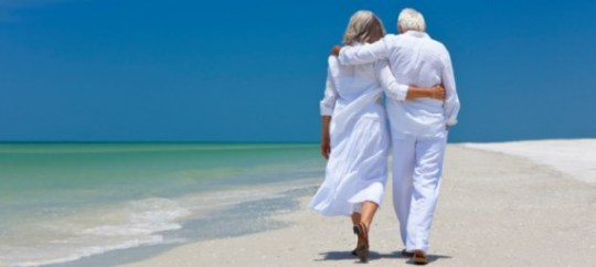 generic-older-couple-walking-down-beach-730x328